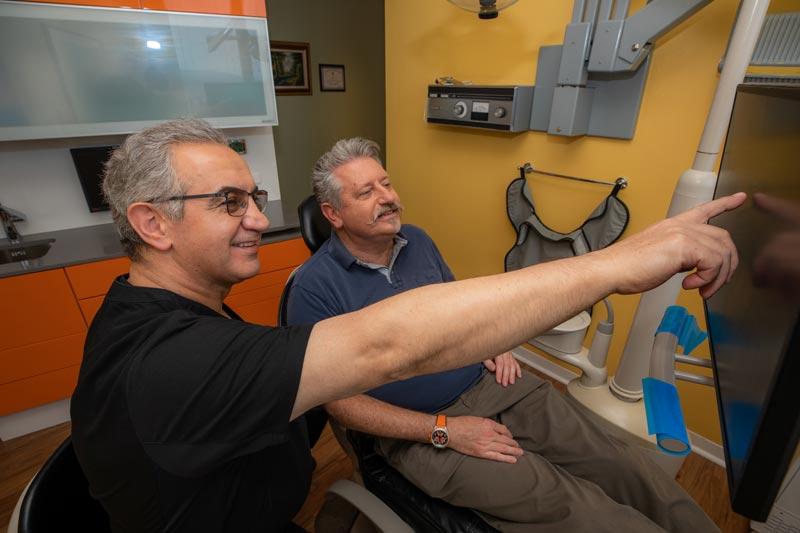Dr. Ali showing patient scans
